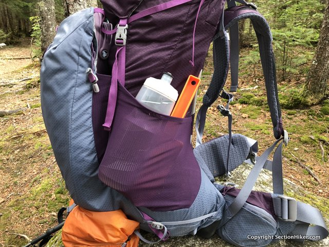 The side water bottle pockets are covered with a tough mesh